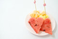 Toothpick stab on pineapple cantaloupe and watermelon white table Stock Photography