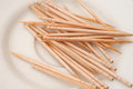 Toothpicks on a plate used small white Stock Images