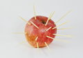 Toothpicks stab into red apple an Stock Photography