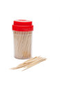 Toothpicks toothpick container and loose on a white background Royalty Free Stock Photos
