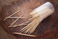 Toothpicks wooden in a mess on wood background Stock Photo