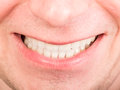 Toothy smile on a male face focus is on the teeth Royalty Free Stock Photos