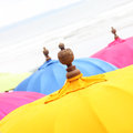 Top of a colorful beach umbrella against the sky Stock Photos