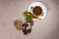 Top down view of beans with hot coffee inside Royalty Free Stock Photo