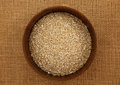 Top down view of a bowl of steel cut oatmeal irish on burlap bag Royalty Free Stock Images