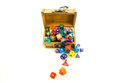 Top down of wooden chest overflowing with dice shot a small multicolored Stock Photography