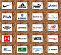 Top famous sportswear companies brands and logos collection of of most popular on white tablet on rusted wooden background Stock Photography