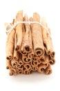 Top front view bundle of Raw Organic Cinnamon sticks (Cinnamomum verum). Royalty Free Stock Photo