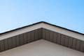 Top of house roof edge on clear sky. Royalty Free Stock Photo