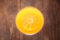 Top orange juice in glass, fresh fruits on wooden background Royalty Free Stock Photo