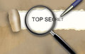 Top secret the word appearing behind torn brown paper Royalty Free Stock Photos