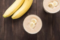 Top shot banana smoothie on wooden table Royalty Free Stock Photo