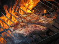 A top sirloin steak flame broiled on a barbecue, shallow depth o Royalty Free Stock Photo