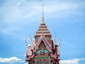 Top of thai temple achitecture on blue sky Stock Photos