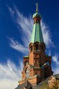 Top tower of tampere orthodox church with blue sky and clouds Stock Photo
