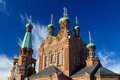 Top towers of tampere orthodox church with blue sky and clouds Stock Image