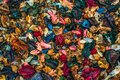 Top view of aromatherapy potpourri mix of dried aromatic flowers texture background, many beautiful vibrant colors. flat lay