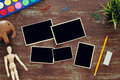 Top view of artist art supplies background next to empty photo frames collage. Copy space. Royalty Free Stock Photo