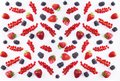 Top view. Background of black and red food. Ripe red currants, strawberries and blackberries on a white background. Mixed berries Royalty Free Stock Photo