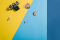Top view of beach with accessories on colourful graphical background Royalty Free Stock Photo