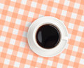 Top view of black coffee cup on checked tablecloth Stock Images