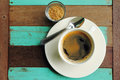Top view of a black coffee in white cup with sugar on old wood. Royalty Free Stock Photo