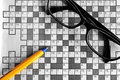 Top view of blank crossword puzzle with eyeglasses and a p Royalty Free Stock Photo