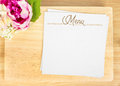 Top view of blank wooden plate with white menu card and flower pot on table mock up for adding your design clipping path on Royalty Free Stock Photo