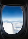 Top view on the blue sky and clouds from airplane aircraft engine Stock Photos