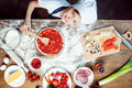 Top view of boy making pizza with pizza ingredients, tomatoes, salami and mushrooms Royalty Free Stock Photo