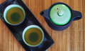 Top view of the brewed and healthy Japanese green tea served in traditional hohin and shiboridashi dishes Royalty Free Stock Photo