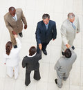 Top view of a business colleagues shaking hands Stock Photos