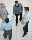 Top view of a business men handshaking at work Stock Image