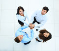 Top view of business people with their hands together in a circle Royalty Free Stock Photography