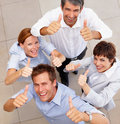 Top view of a business team showing a success sign Royalty Free Stock Images