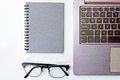 Top view of business working place with notepad,modern glasses,k Royalty Free Stock Photo