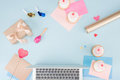 Top view of cakes with laptop and party horns with beanbag mock-up Royalty Free Stock Photo
