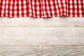 Top view of checkered tablecloth on white wooden table. Royalty Free Stock Photo