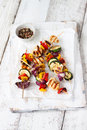 Top view of chicken skewers or shashlik with grilled vegetables Royalty Free Stock Photo