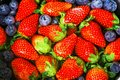 Top view- close up fresh strawberries and blueberries background, organic fruit concept with high vitamins that are beneficial to