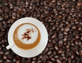 Top view of coffee cup with coffee beans. Stock Image