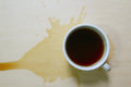 Top view of coffee cup and stains on wooden board Royalty Free Stock Images
