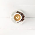 Top view coffee cup white beans on table Stock Photo