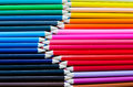 Top view of collection of colorful pencil crayons lined up in ro a colourful together rows meeting at the tips whole image is Royalty Free Stock Images
