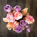 Top view of colorful roses bouquet on wooden background Royalty Free Stock Photos