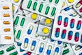 Top view of colorful tablets and capsules pills in blister packs. Royalty Free Stock Photo