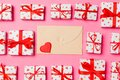 Top view of colorful valentine background made of craft envelope, gift boxes and red textile hearts. Valentine`s Day concept Royalty Free Stock Photo