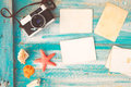 Top view composition - Blank paper photo frames with starfish, shells, coral and items on wooden table Royalty Free Stock Photo