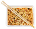 Top view of cooked instant ramen and wooden chopsticks in foam cap isolated on white background Royalty Free Stock Image