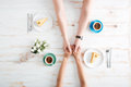 Top view of couple holding hands and eating dessert Royalty Free Stock Photo